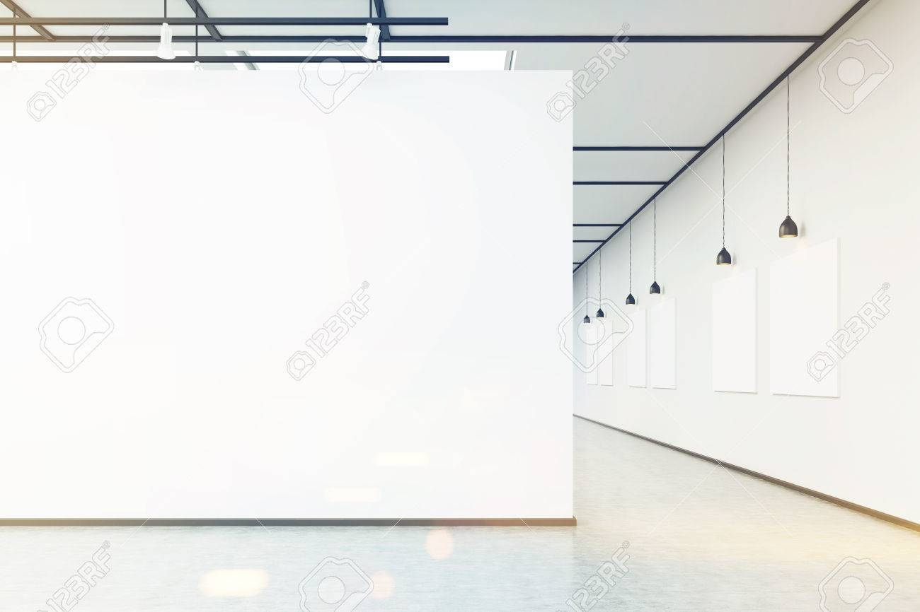 Art Gallery With Large White Wall And Several Empty Banners Within Latest Large White Wall Art (View 2 of 20)