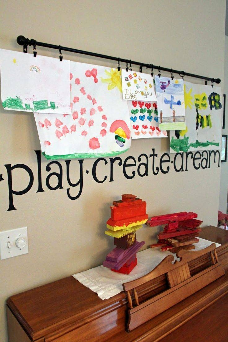 Cute Way To Display Children's Artwork – Curtain Rod, Hooks, And Intended For Newest Preschool Classroom Wall Decals (View 8 of 30)