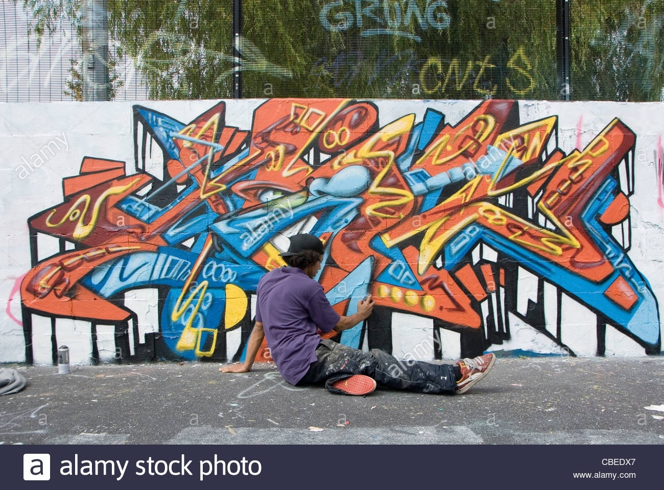 Teenage Boy Painting Abstract Graffiti Art Mural On Wall, From Intended For Latest Abstract Graffiti Wall Art (View 19 of 20)