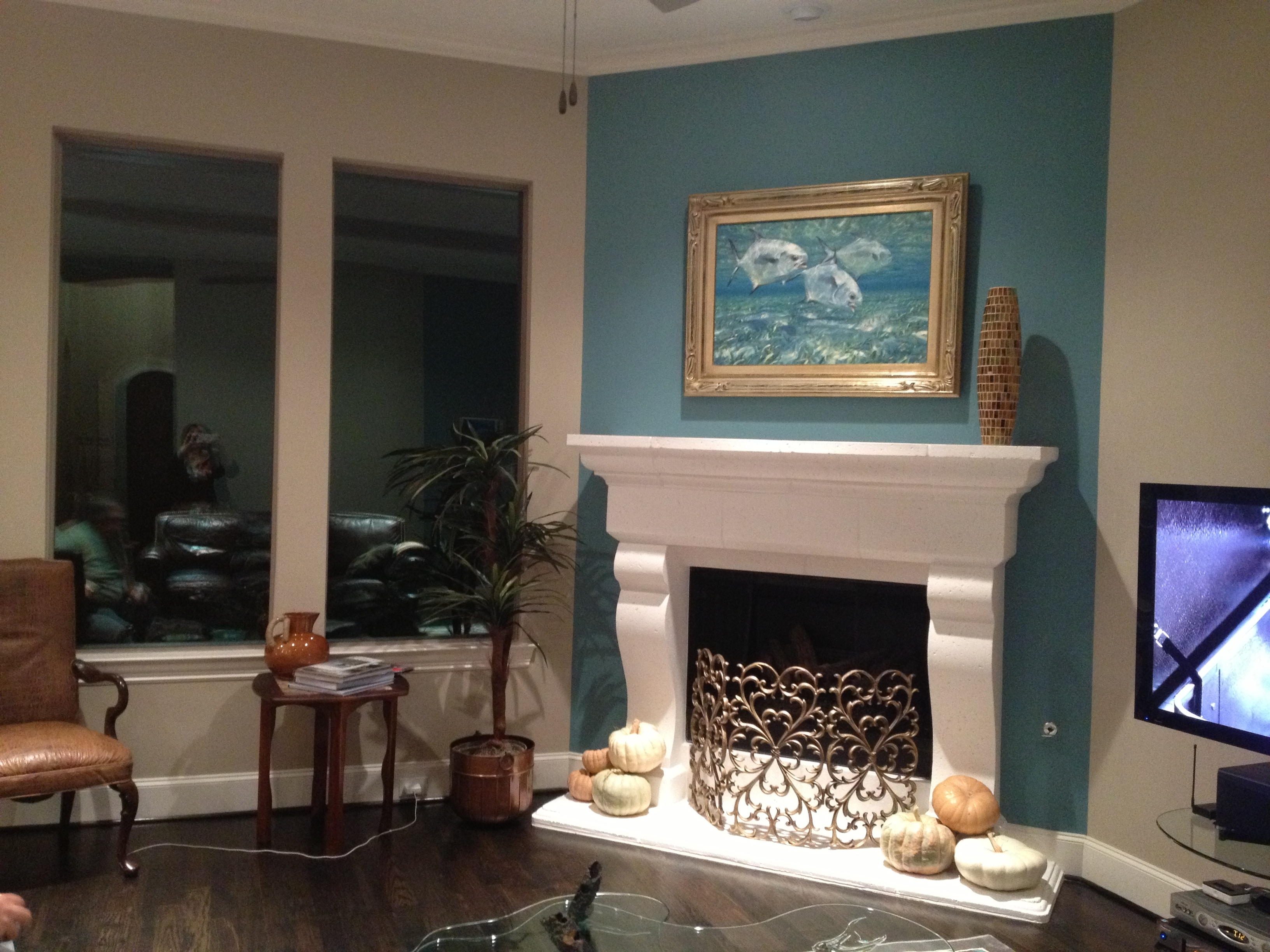 Fireplace Accent Wall Complements Painting (View 3 of 15)