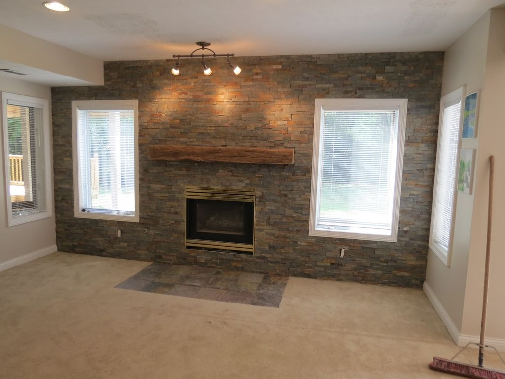 Grey Exposed Brick Stone Accent Wall Combine With Wooden Fireplace In Most Recent Wall Accents Over Fireplace (View 9 of 15)