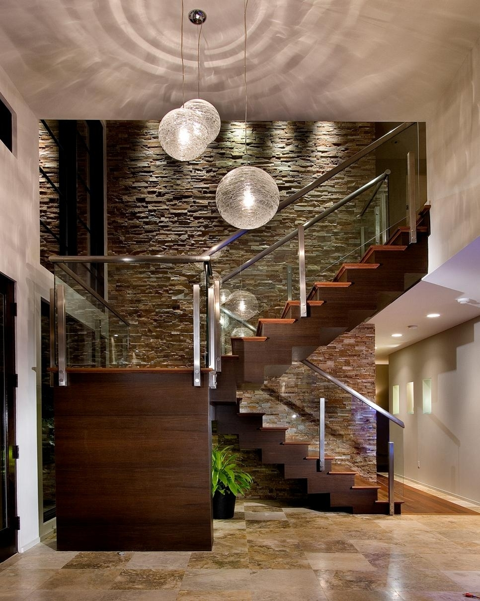 Stacked Stone Contemporary Home With Midcentury Modern Elements For Most Up To Date Entrance Wall Accents (View 8 of 15)