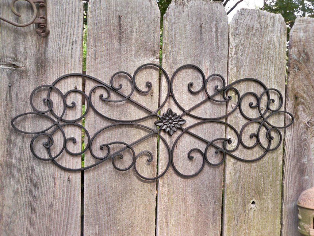 How To Outdoor Metal Wall Decor Drilling Holes In The Siding Intended For Recent Ornamental Wood And Metal Scroll Wall Decor (Gallery 10 of 20)